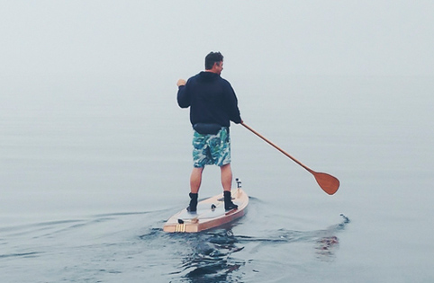 Man paddle boarding on Silver Lake