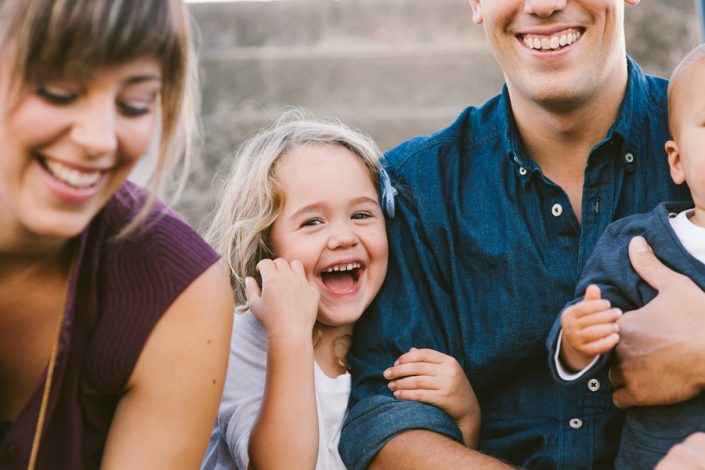 Laughing young family