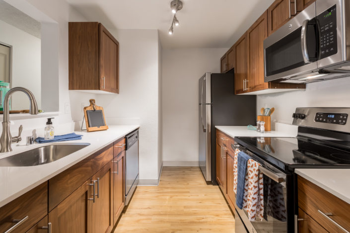 Spacious kitchen with all-new, real wood cabinetry. Artesia Apartments, Everett, WA