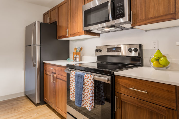 Spacious kitchen with all new microhoods. Artesia Apartments, Everett, WA