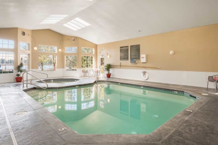 Year-round, heated indoor swimming pool - Artesia Apartments in Everett, WA